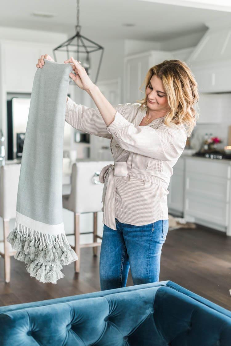 Add lightweight throw blankets for spring. #ad #AthomeStores #springdecorating #springdecoratingideas #coastallivingroom