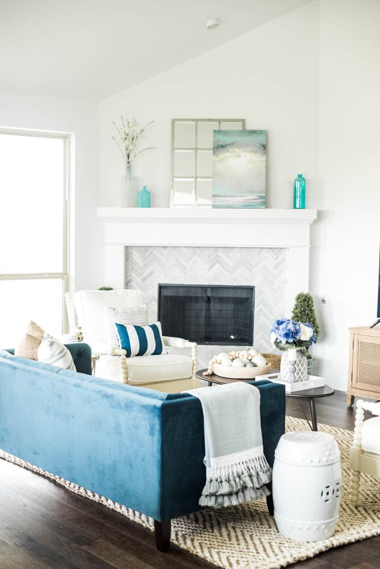 Spring touches with a coastal vibe. #ad #AthomeStores #springdecorating #springdecoratingideas #coastallivingroom