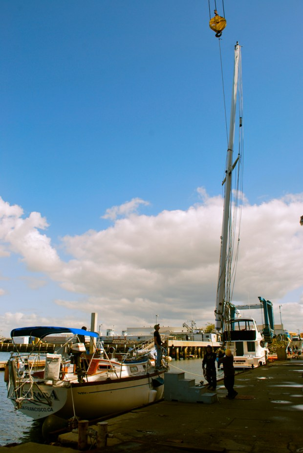 Astraea's main mast getting hoisted by Knight and Carver's crane