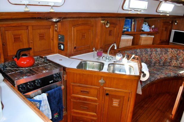 View forward of the galley. Opposite the stove on starboard is a large locker and the head.