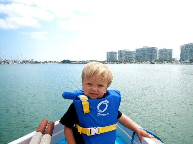 Sully's enjoying dinghy rides more now. He even reached down to play in the water as we cruised the bay.