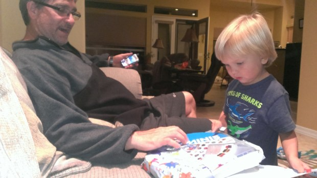 Grandpa Ted and Sully playing trains. It was almost Sully's birthday so Sully got some new portable toy trains.