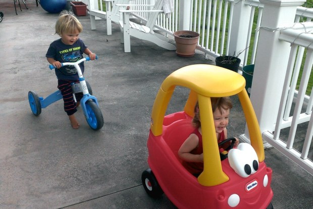Sully and Elena loved driving the car and tricycle on the porch, they even raced!