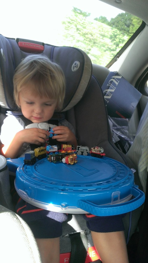 Playing trains in the car on the road! Sully enjoyed the ride.