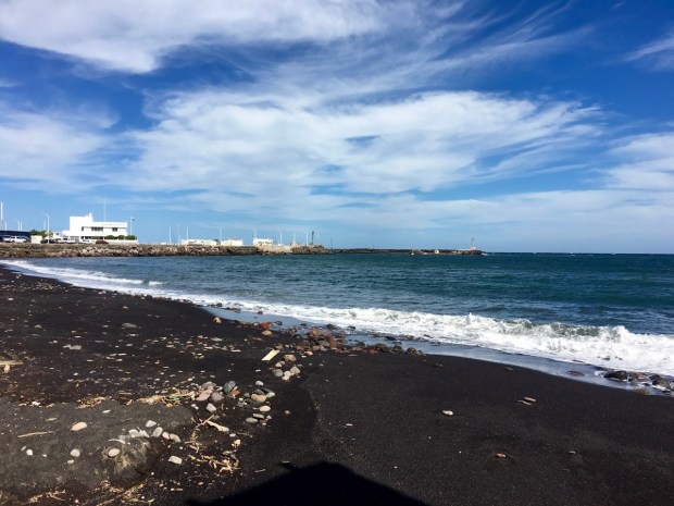 The black beach south of the marina