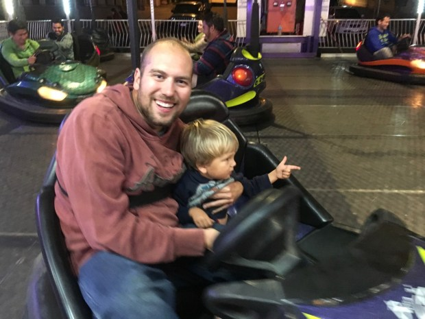 "After being terrified with Mommy, Nate took Sully on the bumper cars and had a blast! When he got off he said, ""Daddy rides are better."""
