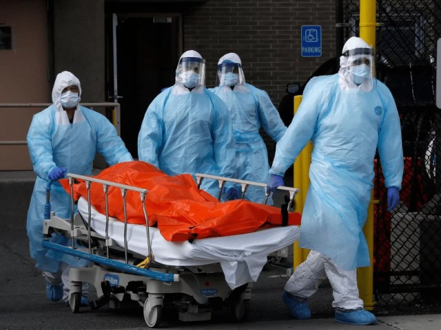a patient on a gurney being wheeled into a care facility