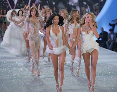 Victoria's Secret Fashion Show Models on runway.