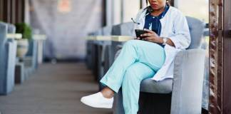 Healthcare worker reading an ebook