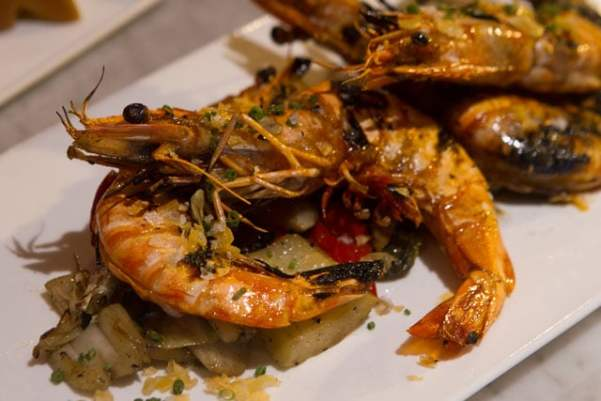 JUMBO SHRIMP: Cooks & Soldiers' head-on Madagascar prawns with charred onion, cabbage, and sweet peppers