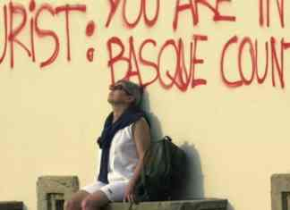 A woman takes in the sunshine in San Sebastian, in the Spanish Basque region.