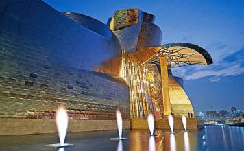 Guggenheim Bilbao with Yves Klein's Fire Fountain artwork, 1961 (fabricated in 1997) | Photograph courtesy Guggenheim Bilbao