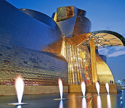Guggenheim Bilbao with Yves Klein's Fire Fountain artwork, 1961 (fabricated in 1997) | Photograph courtesy Guggenheim Bilbao