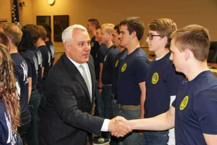 Mayor David Bieter congratulates new enlistees in the United States Navy at Boise City Hall