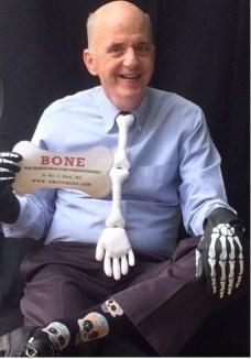 Roy-with-AB-card-and-bone-regalia-double.jpg