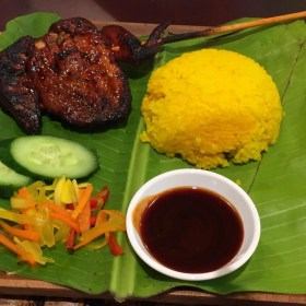Java Rice & BBQ meal on banana leaf