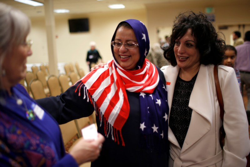 """Sabuhi Siddique, center, chats with Rev. Nancy Palmer Jones, left, from First Unitarian Church of San Jose, and Samina Masood, at before the start of """"Hands Around the Mosque"""" at the Muslim Community Association in Santa Clara, Calif. on Sunday, March 19, 2017. (Nhat V. Meyer/Bay Area News Group)"""