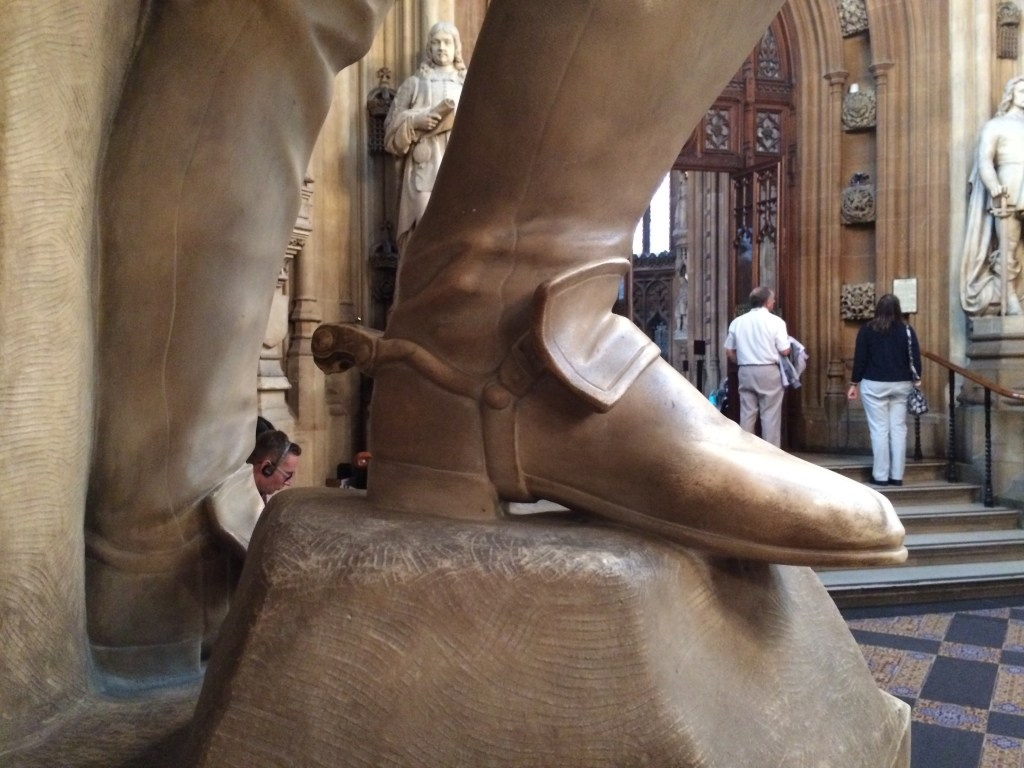 Missiing spur on a statue in St Stephen's Hall, Houses of Parliament