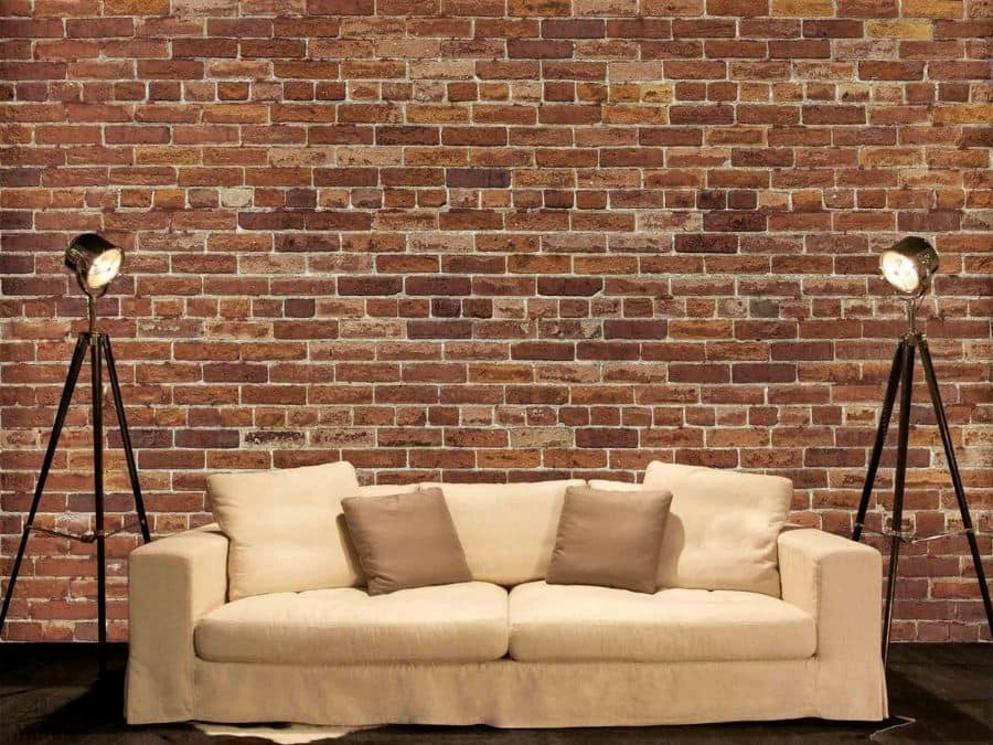 Not Just Another Brick on the Wall Mural, as seen in this living room, is a red brick wallpaper with a textured look. Faux brick wallpaper sold by AboutMurals.ca