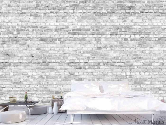 Old Brick Wall Mural Light Black and White, as seen in this white bedroom, creates textured walls with its light and airy grey brick. Grey brick wallpaper sold by AboutMurals.ca.