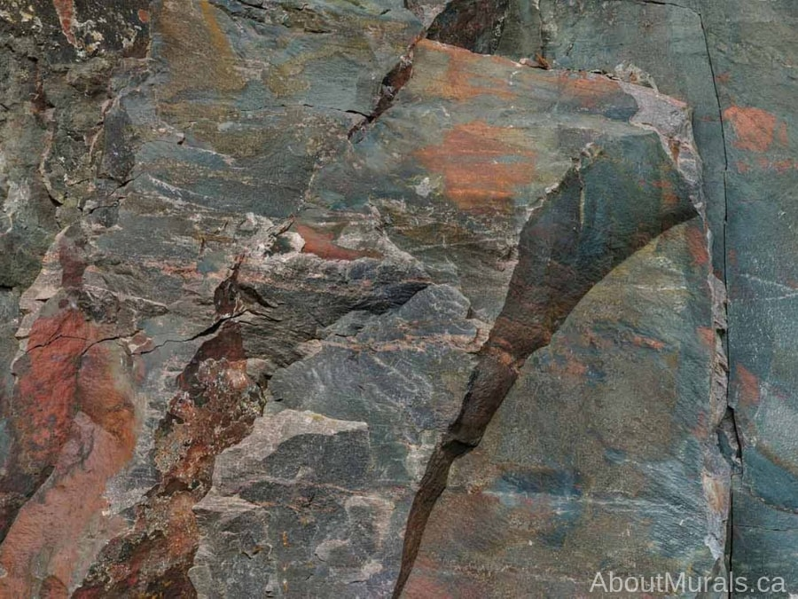 Canadian Shield Rock Face Wallpaper features rugged texture with its gray and rust coloured stone wall. Stone wallpaper sold by AboutMurals.ca.