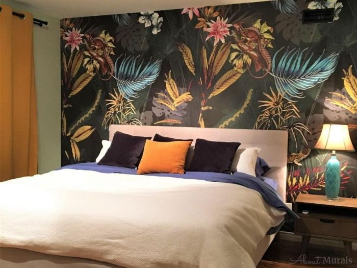 Black Tropical Wallpaper, as seen on this bedroom wall, features exotic flowers, palm leaves, banana leaves and lizards on a dark background. Tropical wallpaper sold by AboutMurals.ca