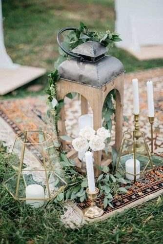lantern-wedding-centerpiece-wooden-lantern-with-a-candle-and-golden-candlesticks-deserae-evenson-via-instagram-334x500