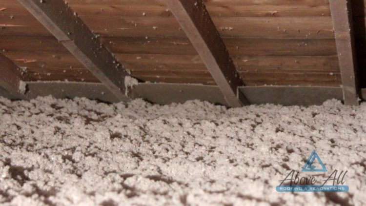 Completed R-50 cellulose insulation with cardboard air-flow chutes installed at eaves edges.