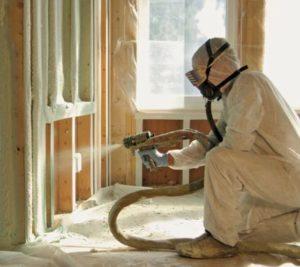 Spraying foam insulation in Winnipeg home.