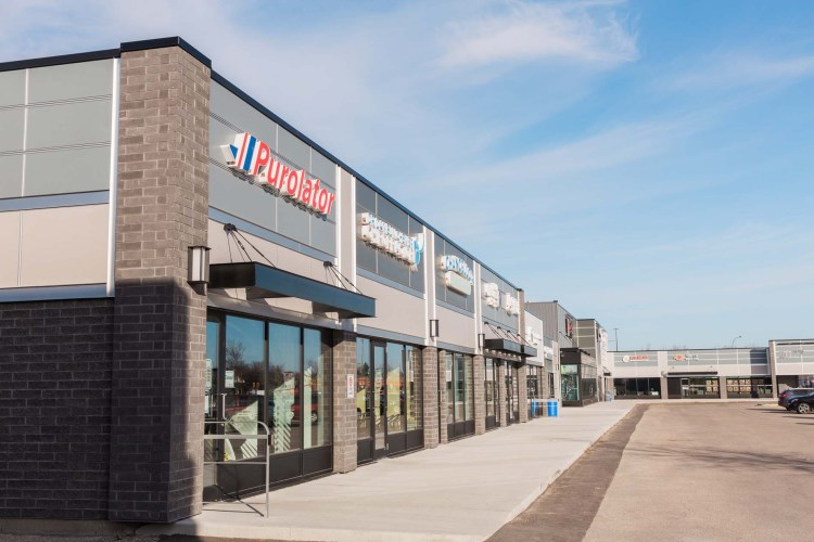 Commercial strip mall with new exteriors in Winnipeg