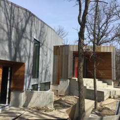 Metal, concrete, and wood siding expertly installed in this Winnipeg custom home.