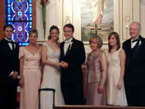Half brother and mother of bride, bride and groom, mother, sister, and father of groom
