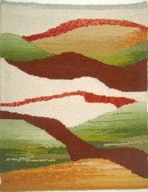 An abstract tapestry representing mountains with fog in the valley below