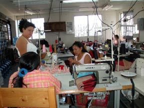 Women working in the sewing workshop at UPAVIM