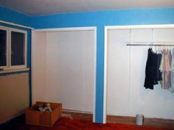 Bright blue paint on walls around the closet