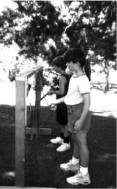 Children outdoors playing chimes