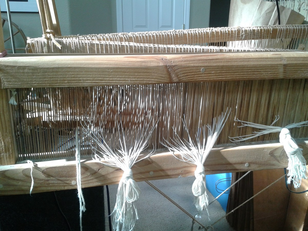 A view of a loom being set up for weaving. The reed has been made of bamboo by Jiame's father.