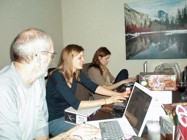 Three people on laptops at the table