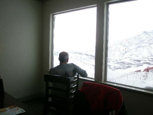 Tom looks out window at mountains