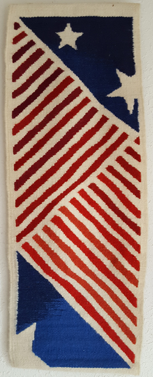 Tapestry with red and white stripes, stars on a blue field