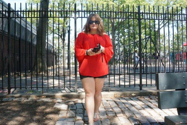 Red Shirt walking toward camera