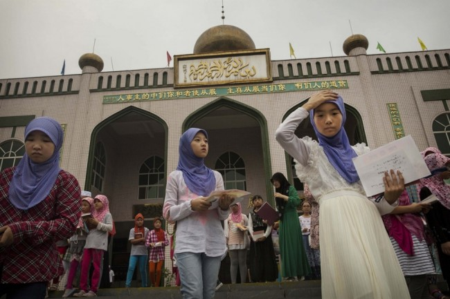 Hui Muslim girls leave a graduation for an Islamic studies course during the holy month of Ramadan at a mosque on July 22, 2014 in Sangpo, Henan Province, China. Kevin Frayer / Getty Images