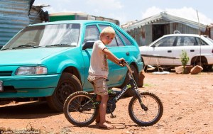 Old cars sit next to the flimsy shelters and makeshift toilets in the camp where families are forced to survive on less than £30 a month