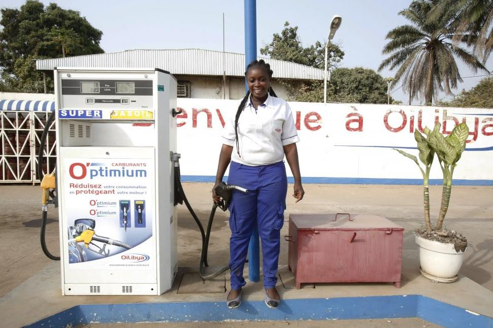 Natenin Konate, a 22-year-old gas station attendant, poses for a photograph in Bouake, Ivory Coast, February 7, 2016. REUTERS/Thierry Gouegnon