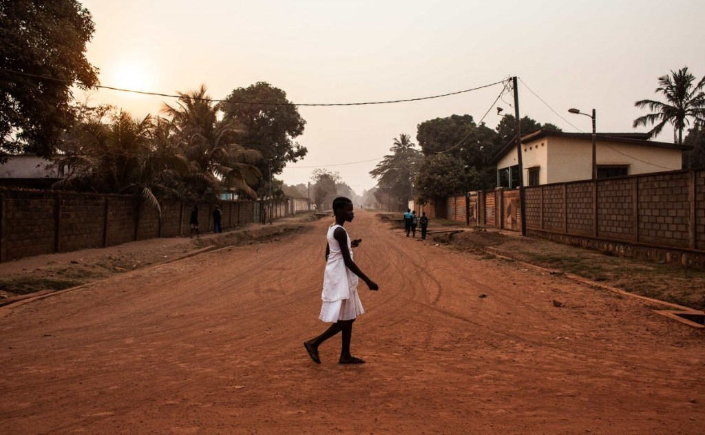 A young girl walks through the Castors neighborhood of Bangui in the Central African Republic. Photos by Jane Hahn