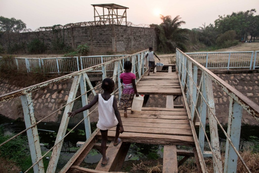 Children cross a dilapidated bridge outside the peacekeeper base near Castors in Bangui, Central African Republic.  Photos by Jane Hahn