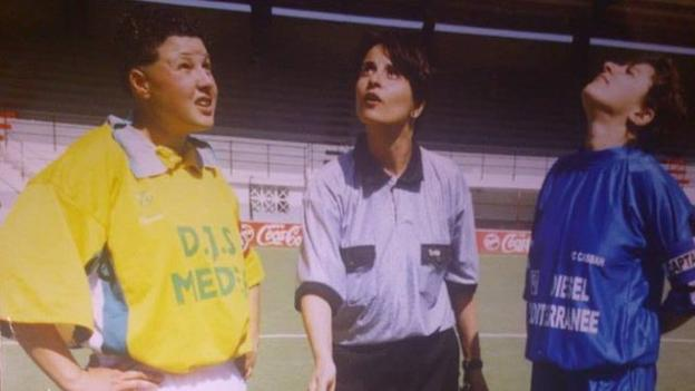 Soumaia Fergani (centre) in her days as football referee