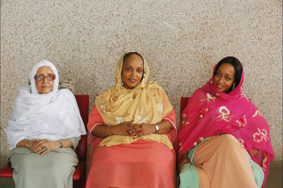 Marie Dem (C), 48, a businesswomam, her mother Fatma Kamil, 79 (L), and her daughter Khadydiatou Dem, 26, pose for a photograph after prayers in Abidjan, Ivory Coast, February 14, 2016. REUTERS/Thierry Gouegnon