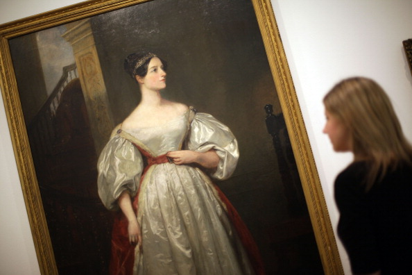 A gallery employee looks at Margaret Carpenter's painting 'Ada Lovelace (1815 -1852) Mathematician; daughter of Lord Byron 1836' at The Whitechapel Gallery exhibition of works from The Government Art Collection on March 9, 2012 in London, England. The exhibition is composed of works chosen by the non-political staff at 10 Downing Street and runs from March 9 - 10 June 2012.  (Photo by Peter Macdiarmid/Getty Images)