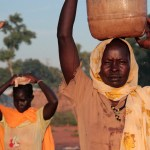 Two women fetch water in Yida refugee settlement. Unity State, July 2013. Credit OCHA.